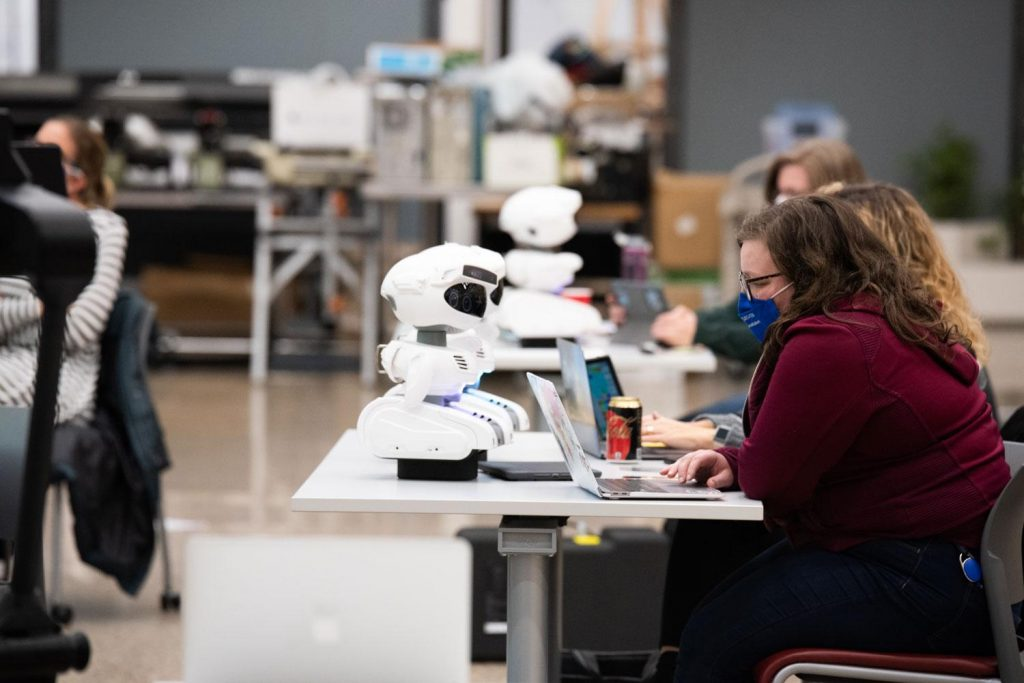 teachers working with Misty robots